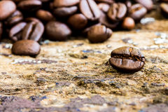 Coffee bean on a wood table Royalty Free Stock Photos