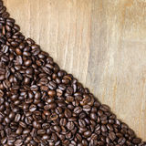 Coffee bean on wooden background Stock Photography
