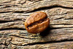 Coffee bean on wooden background Royalty Free Stock Photos