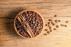 Coffee bean  in wooden bowl on wood texture Stock Photo