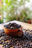 Coffee bean. In wooden cup on table royalty free stock photo