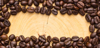 Coffee bean on wooden.Gap in the middle Royalty Free Stock Images