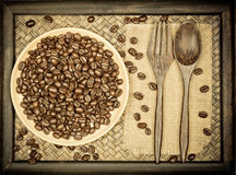Coffee bean in wooden plate. Still life,coffee bean in wooden plate and spoon fork on wood Stock Photos