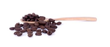 Coffee bean in wooden spoon on white background. stock photos