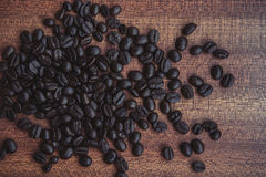 Coffee bean on wooden table Stock Photos