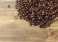 Coffee bean on wooden table background Royalty Free Stock Images