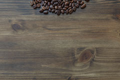 Coffee bean on wooden table background Royalty Free Stock Photos