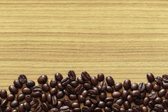 Coffee bean on wooden table background. Dark coffee bean on wooden table background stock images