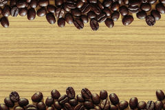 Coffee bean on wooden table background. Dark coffee bean on wooden table background stock photography