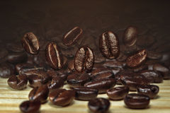 Coffee bean on wooden table. Brown coffee bean on wooden table stock images