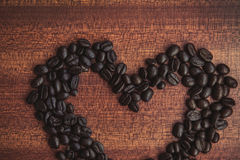 Coffee bean on wooden table Stock Photo