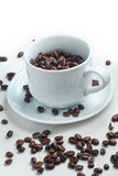 Coffee beans. Cup full of coffee beans Stock Images