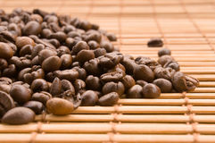 Coffee beans. With bamboo curtain Stock Photos