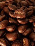 Coffee beans. Roasted coffee beans lying on a table Royalty Free Stock Photography