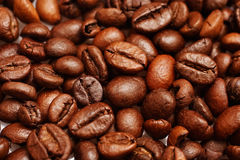 Coffee Beans. Fragrant fried coffee beans a-smoke stock photos