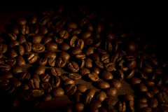 Coffee beans. On brown background Royalty Free Stock Images