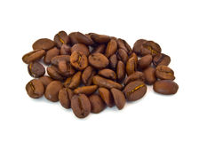 Coffee beans. Some coffee beans on a white background royalty free stock photography