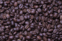 Coffee Beans. Close up of coffee beans showing shape and texture. May be useful as a background Stock Photo