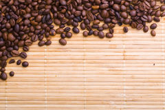 Coffee beans. On the wood mat stock photos
