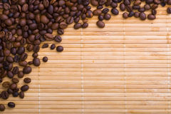 Coffee beans. On the wood mat royalty free stock photo