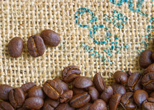 Coffee Beans. Roasted coffee beans are on top of a burlap bag Stock Photo