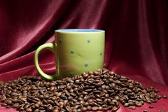 Coffee beans. Around a coffee cup Stock Image