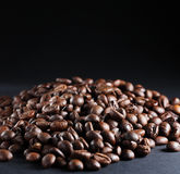 Coffee beans. A lot of roasted coffee beans at dark background stock photos