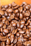 Coffee Beans. Closeup on coffee beans with shallow depth of fiend stock images