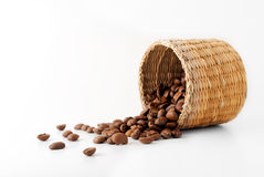 Coffee Beans. A small basket of coffee beans turned over isolated on white background Stock Images