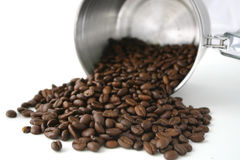 Coffee beans. Spilling from stainless container Royalty Free Stock Photo