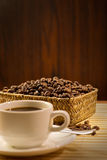 Coffee beans. And cup of coffee stock images