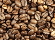 Coffee beans. Light-brown coffee beans background Royalty Free Stock Photos