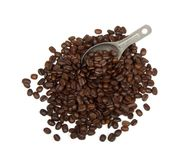 Coffee Beans. Pile of loose coffee beans with a gray scoop dug into them.  Isolated on white background Stock Photos