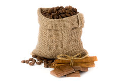 Coffee beans. In canvas sack with cinnamon and chocolate Royalty Free Stock Image