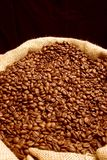 Coffee beans. A lot of roasted coffee beans in a typical coffee bag Stock Photos