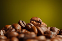 Coffee beans 2. Coffee beans, photographed in yellow background Royalty Free Stock Photo