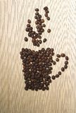 Coffee beans. Cup of coffe from coffee beans royalty free stock photo