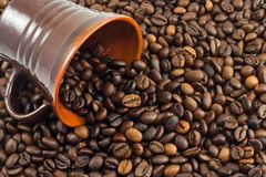 Coffee beans. Falling from a coffee cup Royalty Free Stock Image
