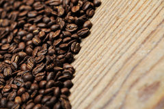 Coffee beans. On wooden table royalty free stock images