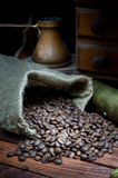 Coffee beans. Vintage coffee grinder and cezve with roasted coffee beans Royalty Free Stock Photos