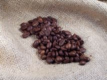 Coffee Beans. On Burlap royalty free stock photos