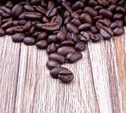 Coffee beans. Dark roasted coffee beans on wooden vintage surface Royalty Free Stock Image