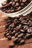 Coffee Beans. Surrounding a bowl filled with beans Royalty Free Stock Photography