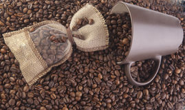 Coffee beans. In a cup and in linen bag Stock Image