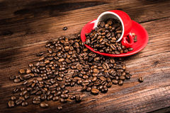 Coffee beans. On a rustic wooden table Stock Photos