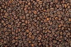 Coffee beans. Covering the entire picture, creating a nice background Royalty Free Stock Photo