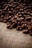 Coffee beans. On hemp cloth Stock Photos