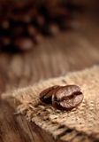 Coffee beans. Close up of coffee beans over wood background Stock Photos