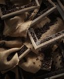 Coffee beans. Background of whole coffee beans on wooden frames and sacking Stock Images