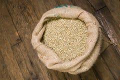Coffee Beans Raw in Burlap Sack Bag Stock Photo